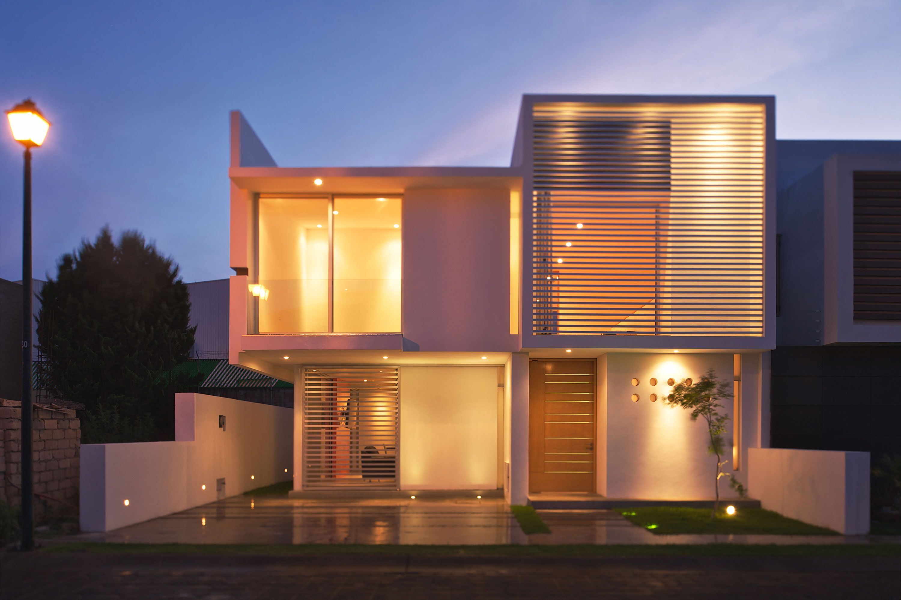 Glass facades become a modern and beautiful feature of for Modern house facade home design
