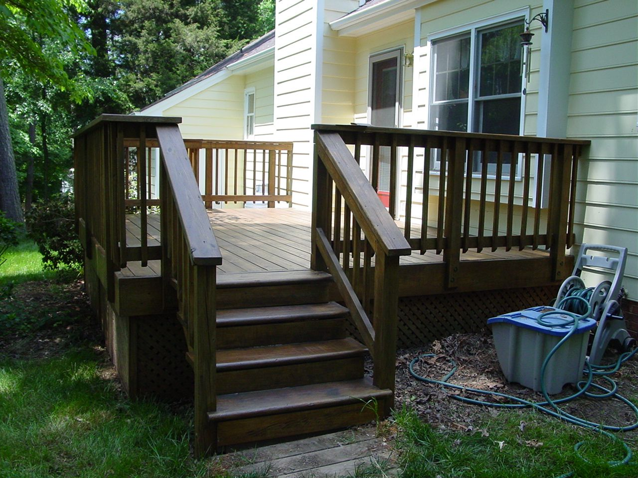 Dark Brown Deck With Yellow House House Deck Deck Pictures Backyard Makeover