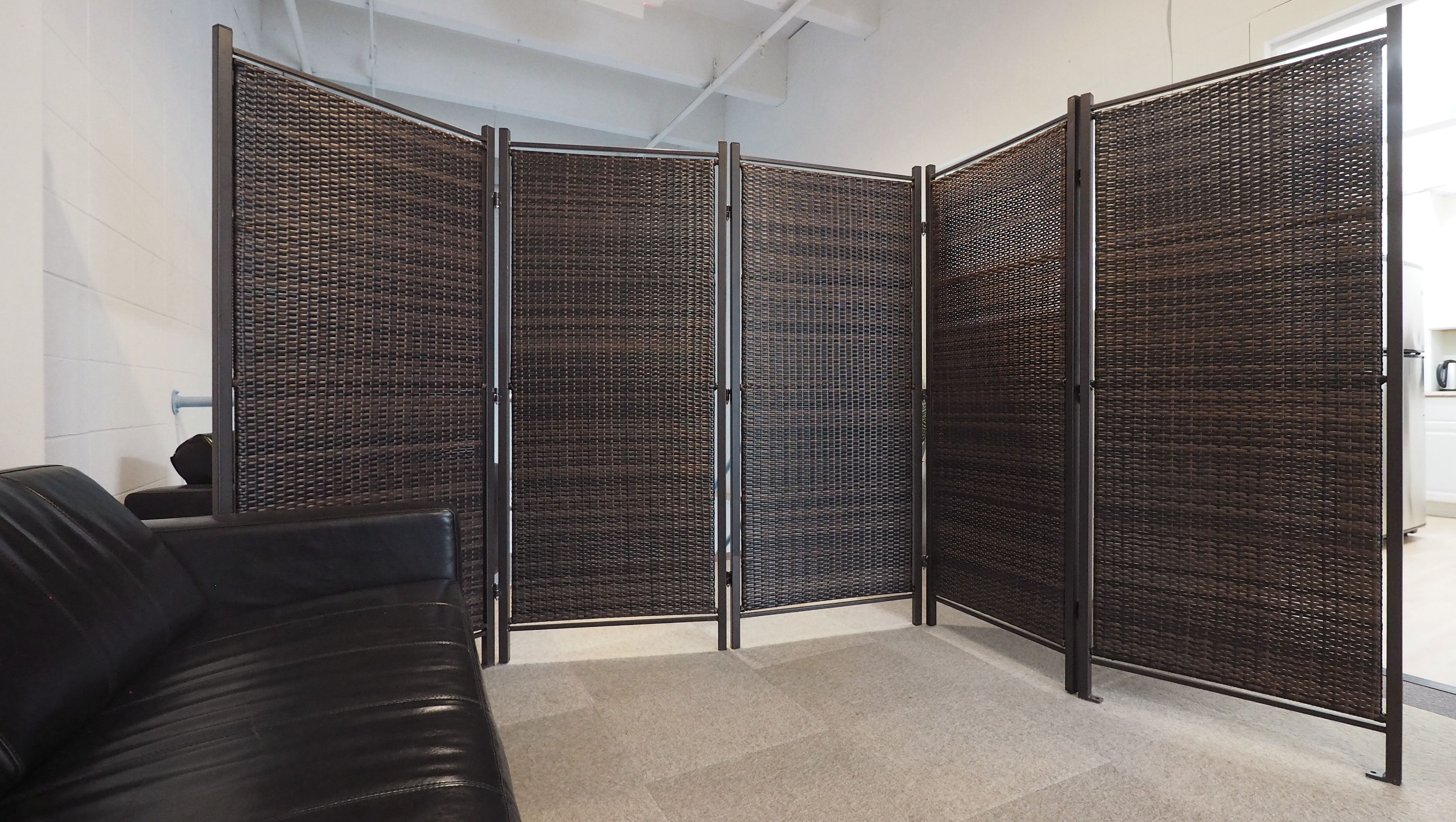 This stylish wicker partition is the perfect outdoor privacy
