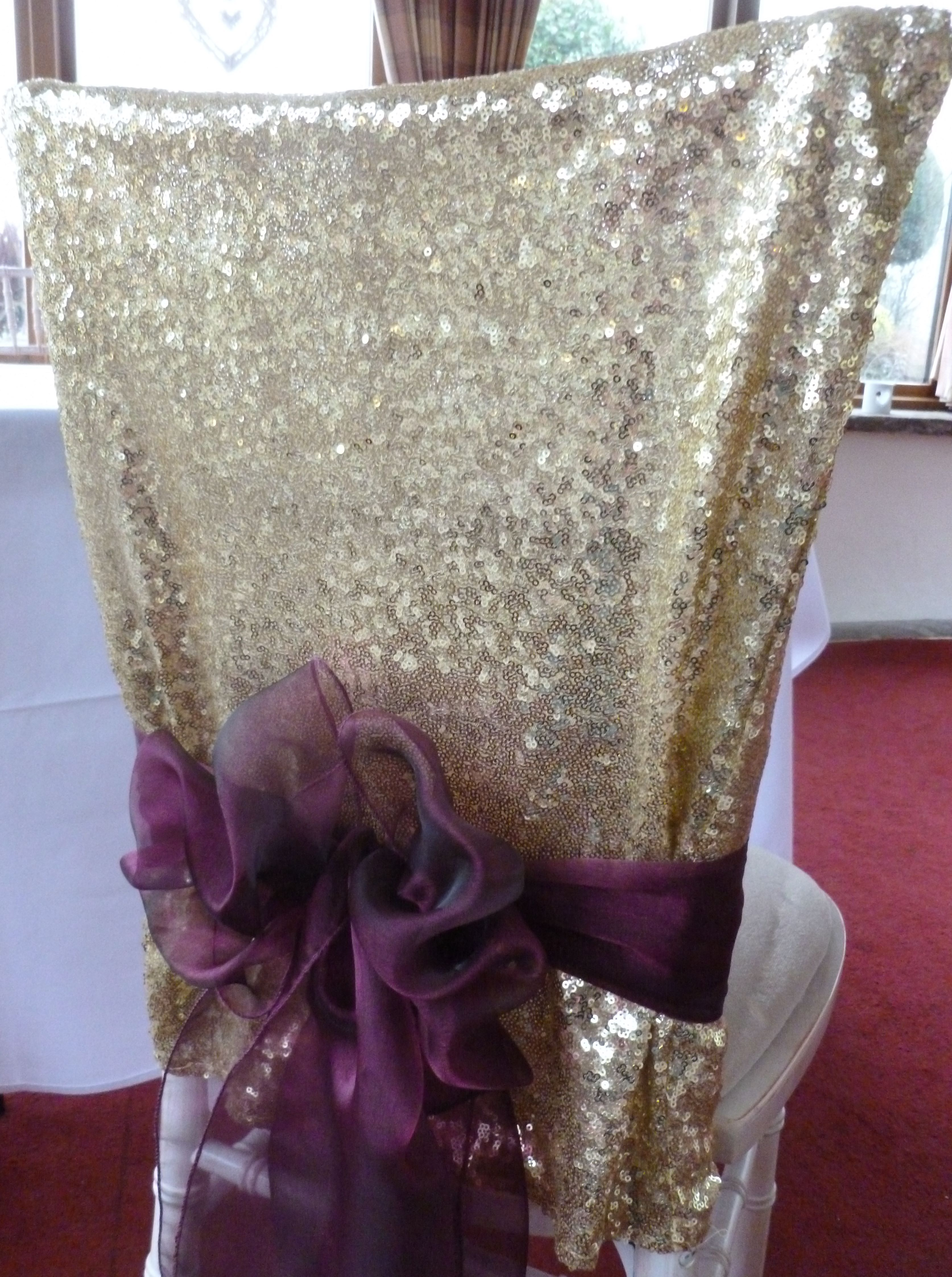 wedding chair covers and bows south wales rustic table chairs gold sequin cap tied with wine organza sash for a christmas cottrell park designed dressed by simply
