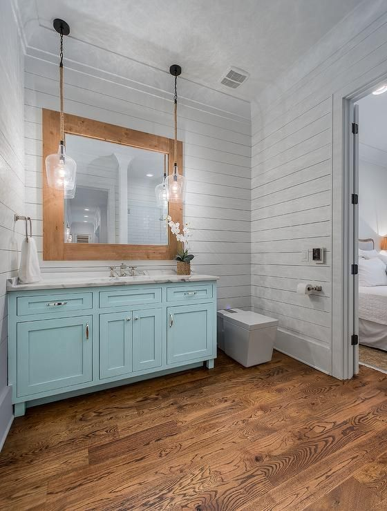 Rustic Glass And Rope Lights Over A Turquoise Blue Bath Vanity With A White Marble Top Turquoise Bathroom Blue Bathroom Brown Bathroom