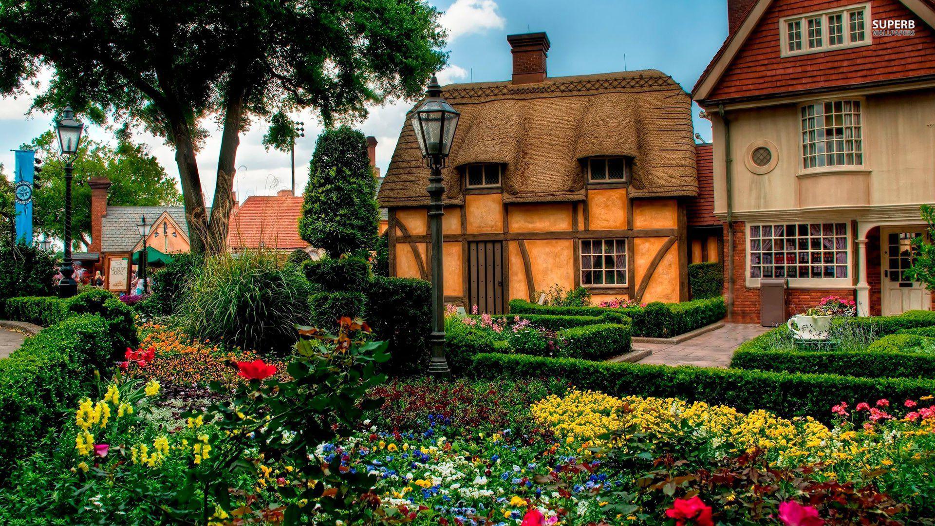 Colorful garden behind old cottage
