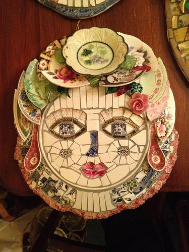 Gorgeous mosaic face surrounded by lovely broken plate halves