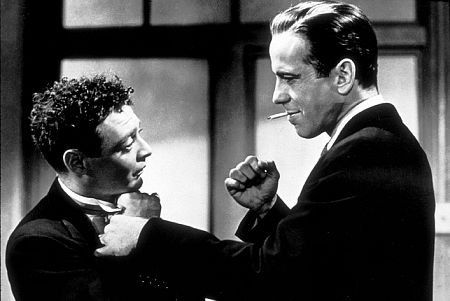 Sam Spade Reasons With Joel Cairo In The Maltese Falcon 1941 Maltese Falcon Movie Humphrey Bogart Film Noir