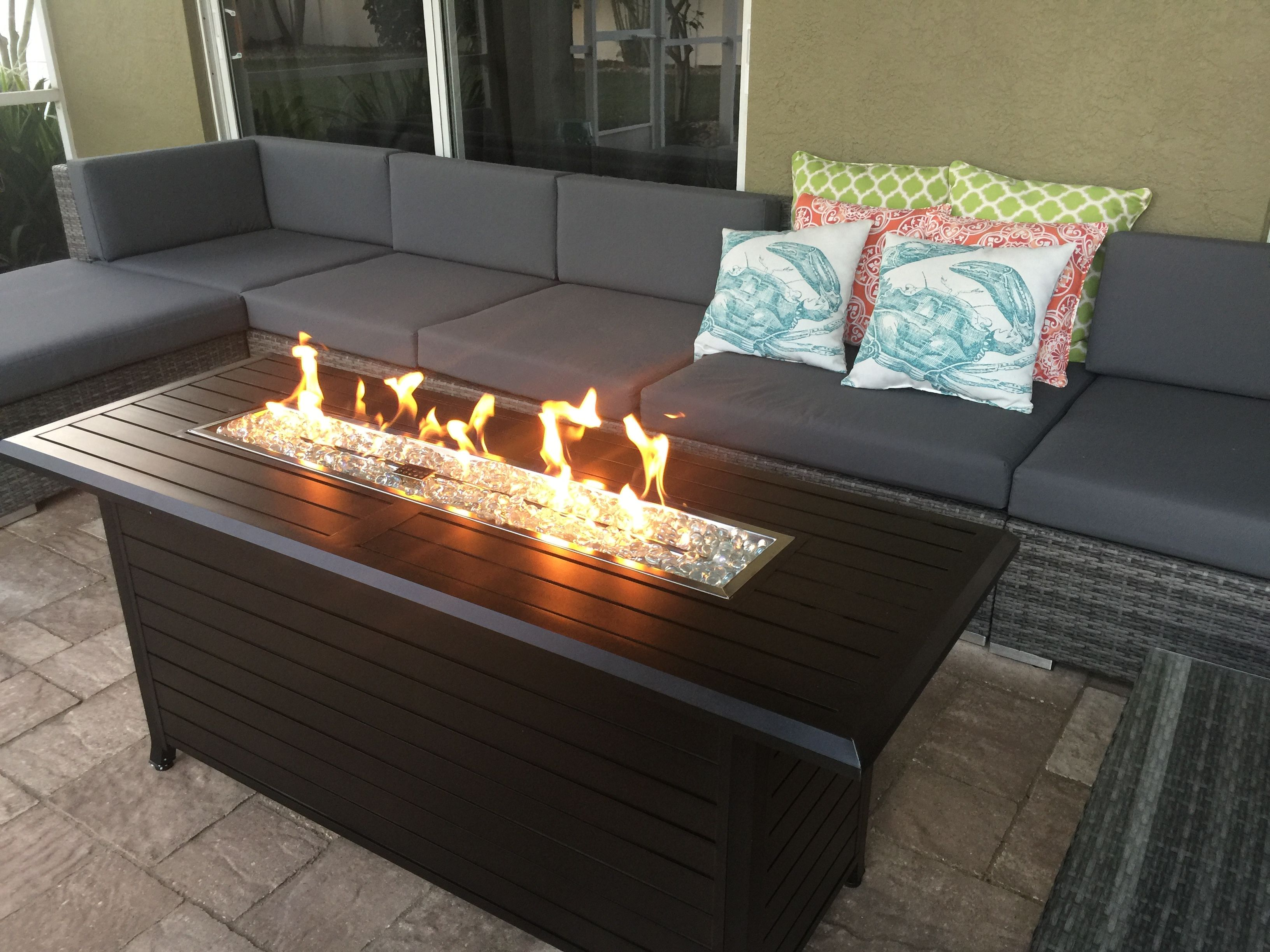 outdoor linear fire pit and seating area on lanai better homes an