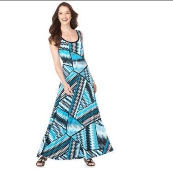 Calvin Klein dress Maxi SZ 10 $119 Calvin Klein Dress, Sleeveless Graphic Printed Scoop Neck Maxi belt not included. Calvin Klein Dresses Maxi