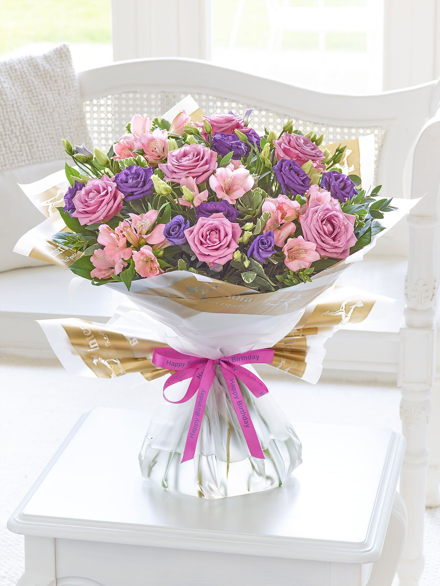 This elegant bouquet is a delightful choice for someone special this elegant bouquet is a delightful choice for someone special izmirmasajfo Images