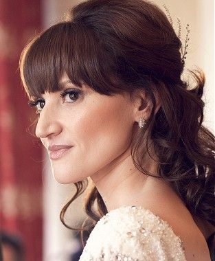 a long brown curly wedding bridal updo with bangs