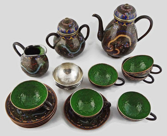 Extraordinary Japanese cloisonne tea set from the Meiji period (1868 to 1912) decorated with dragons and dark green orange peel textured enamel interiors. $2,800 on GoAntiques