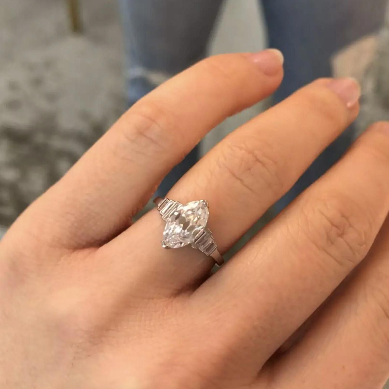 Marquise Baguette Diamond Engagement Ring Circa 1928 The Carmen Ring Is A Marquise Marquise Diamond Engagement Ring Bridal Ring Band Beautiful Engagement Rings