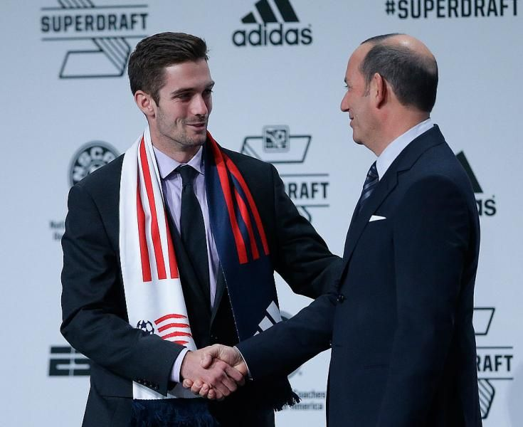 Steve Neumann, left, shakes hands with Commissioner Don Garber after being selected by the New England Revolution during the 2014 Major League Soccer SuperDraft