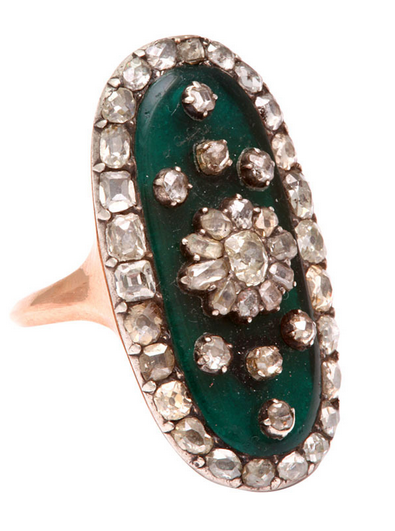 Rare and Opulent Georgian Diamond Ring,  The ring is an elongated vitreous green oval, a forest green and a rare color in antique rings. The diamond flower, accents and perimeter are a mix of rose and table cut stones, set in closed back settings with silver cut down collets. The back and shank are completely original in a pale rose gold of 18kt. Very small, possibly French marks on the shank