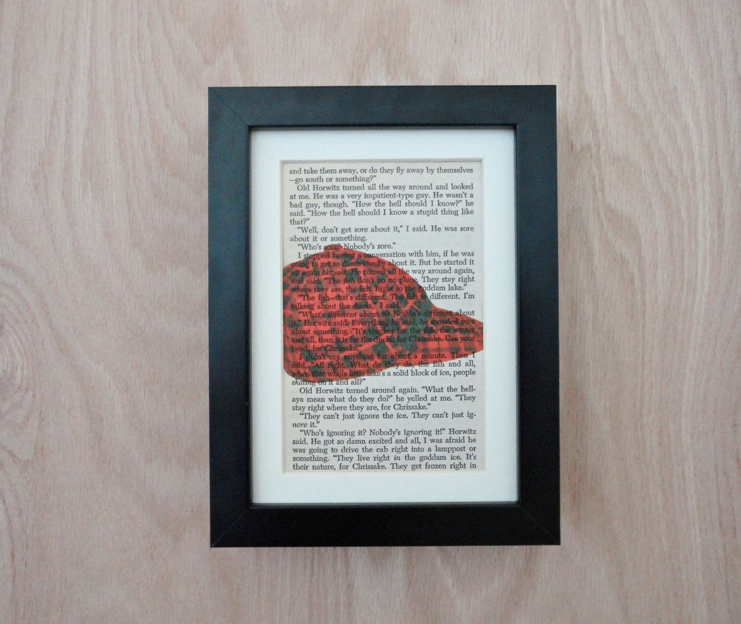 Catcher in the Rye Vintage Original Art, Red Hunter Cap on Actual Book Page. $9.90, via Etsy.
