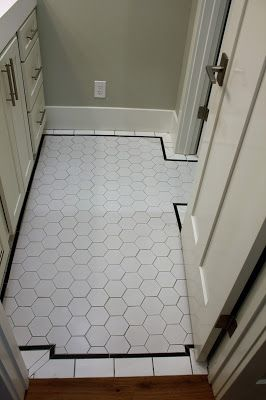 Hall Bath Floor With Large White Hex Tile And Black Pencil Border