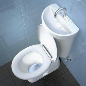 Ceramic Toilet / Sink Combo. Sink Is On The Lid Of The Toilet Tank.