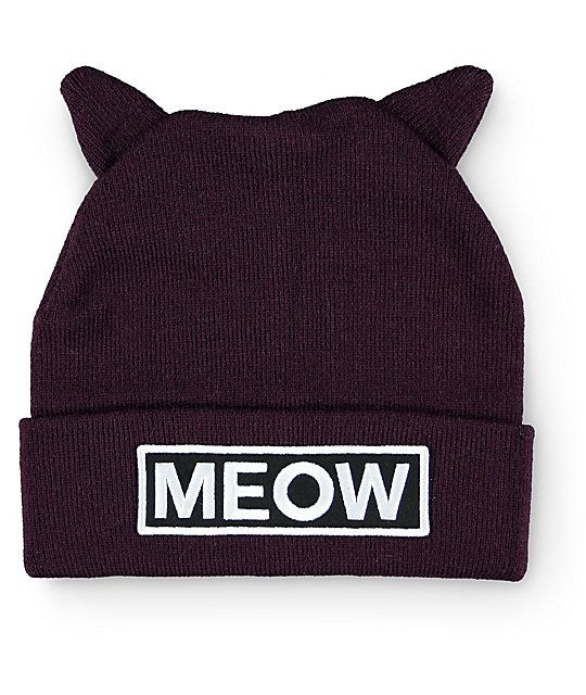 """Finish off any outfit with some serious cat-titude in this cuffed style beanie that features cat ear detailing at the top and a """"Meow"""" patch embroidered at the cuff."""