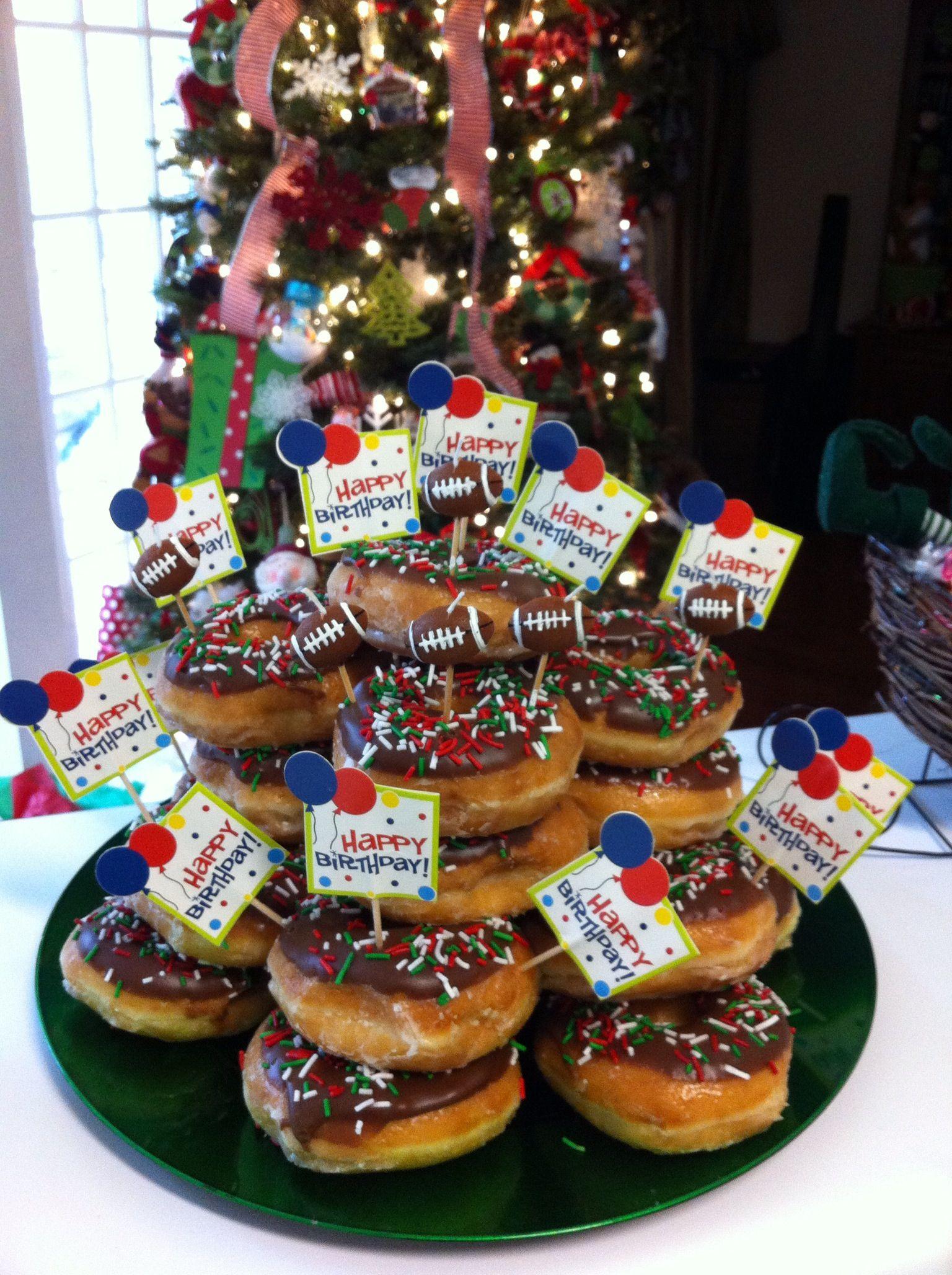 Doughnut birthday cake made using 2 dozen krispy kreme