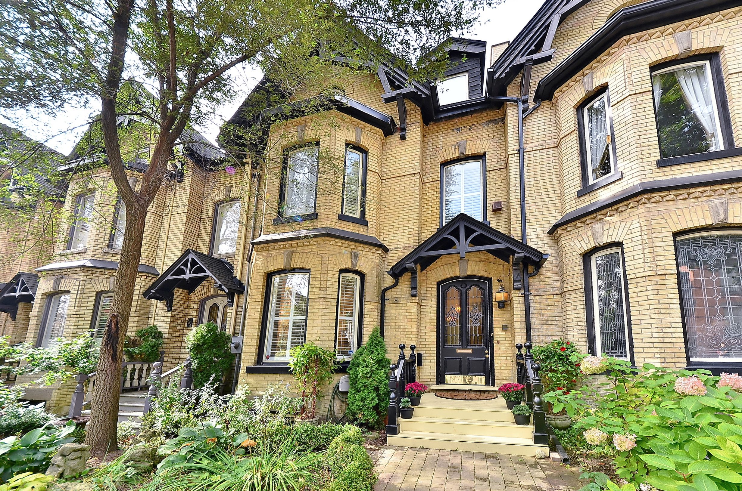 Stretch of yellow brick victorian homes in cabbagetown for Brick victorian house