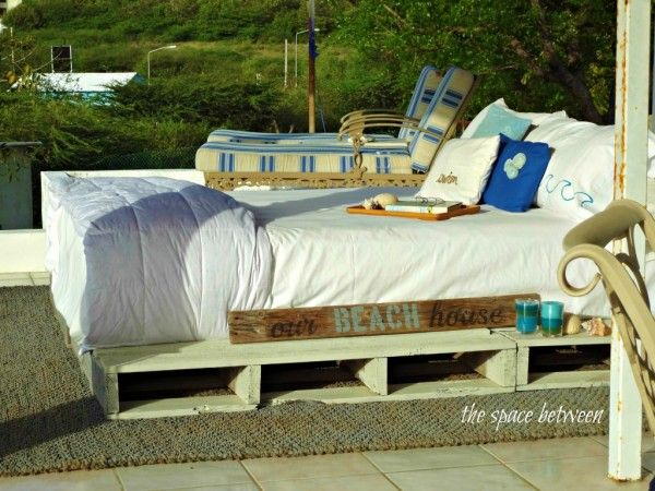 beach house rooftop pallet bed, featured on Remodelaholic