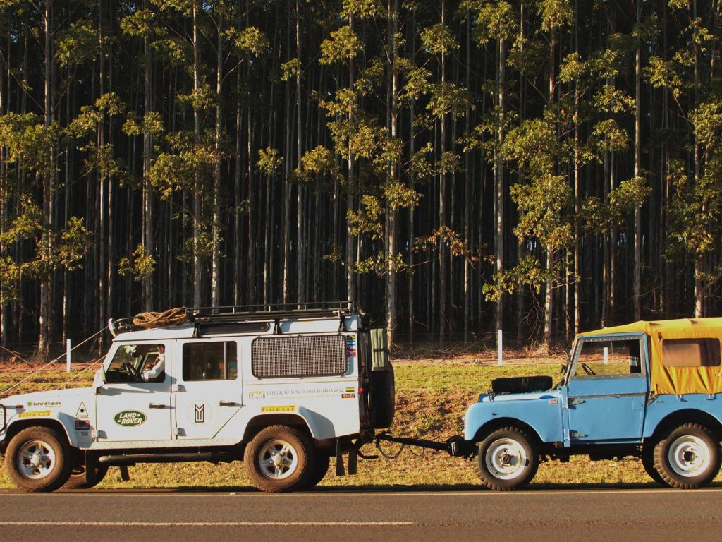 JBK Land Rover Defender towing a Series 1