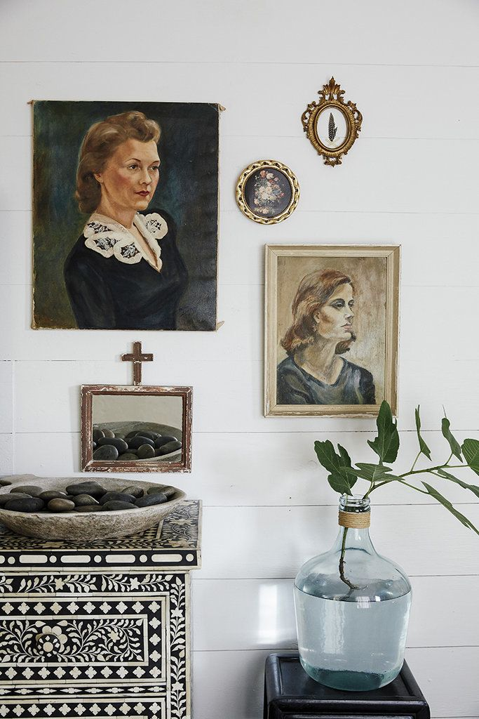 Paige mixed smaller frames and accessories with traditional paintings for an eclectic gallery wall. Source: Cody Ulrich via Homepolish