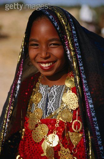 Girl in traditional dress at Sahara Festival, Looking at Camera, Front view, Douz, Tunisia