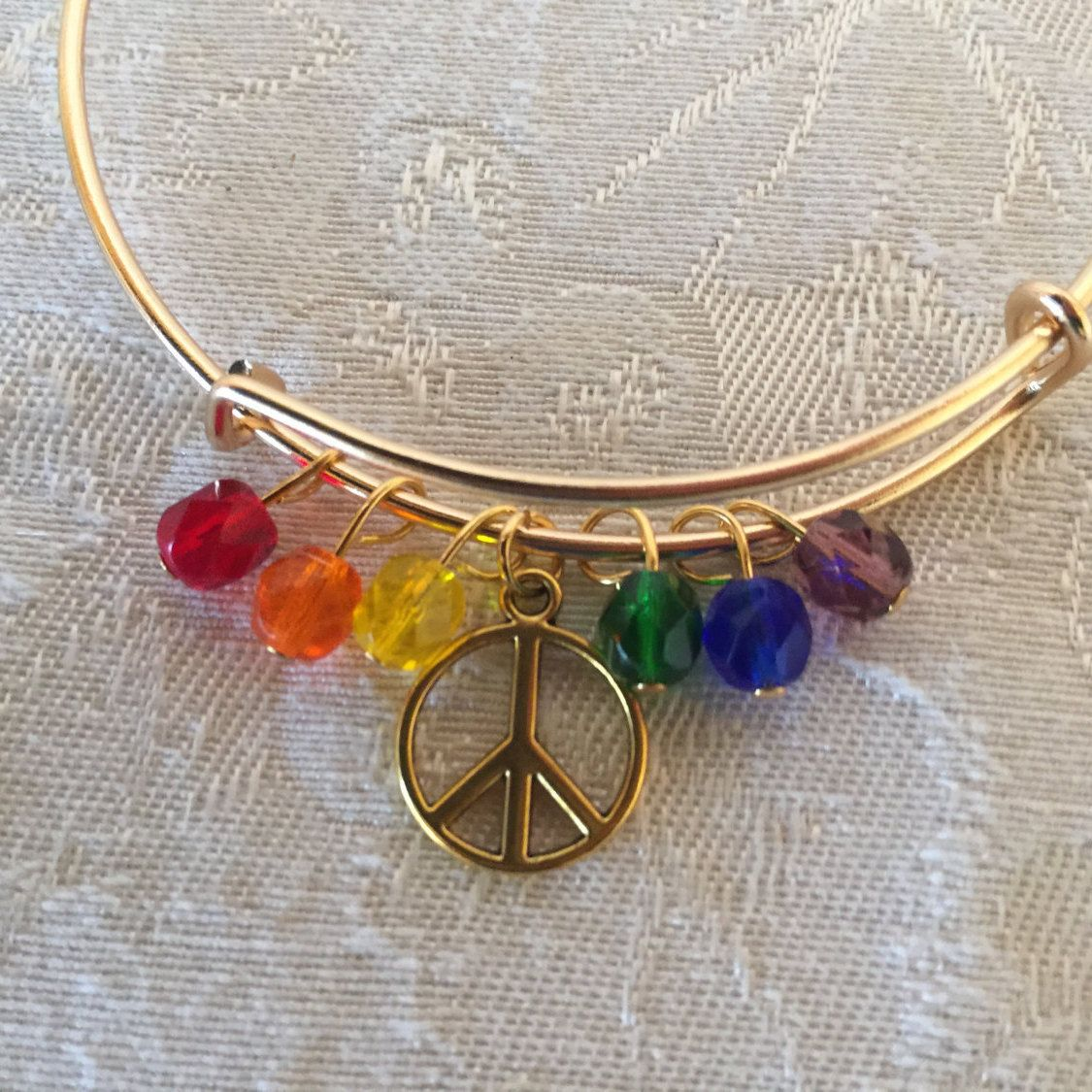 Peace Sign Charm And Crystal Adjustable Wire Bangle Bracelet Gold Tone by cbfcreationsHB on Etsy