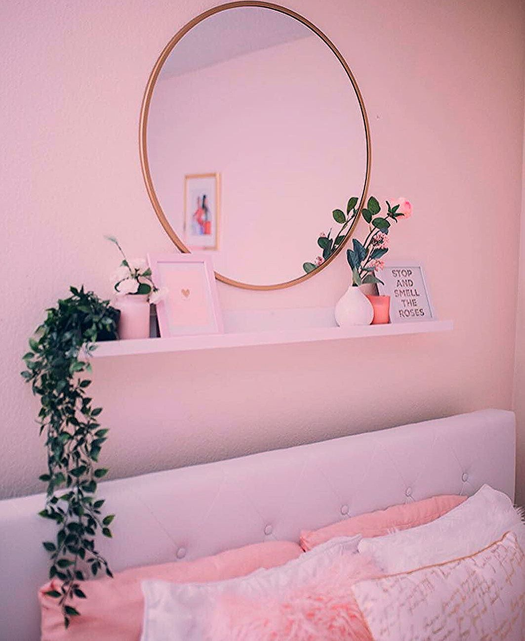 Small shelf and mirror above bed I like this a lot