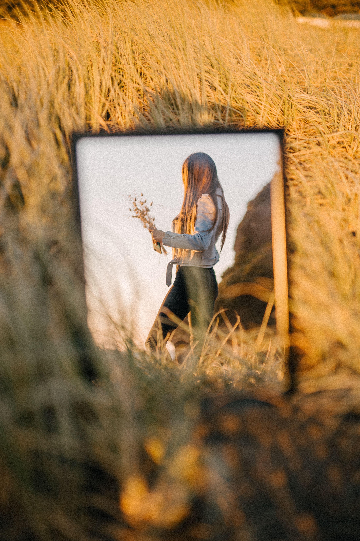 Photo of Golden hour portrait through the mirror