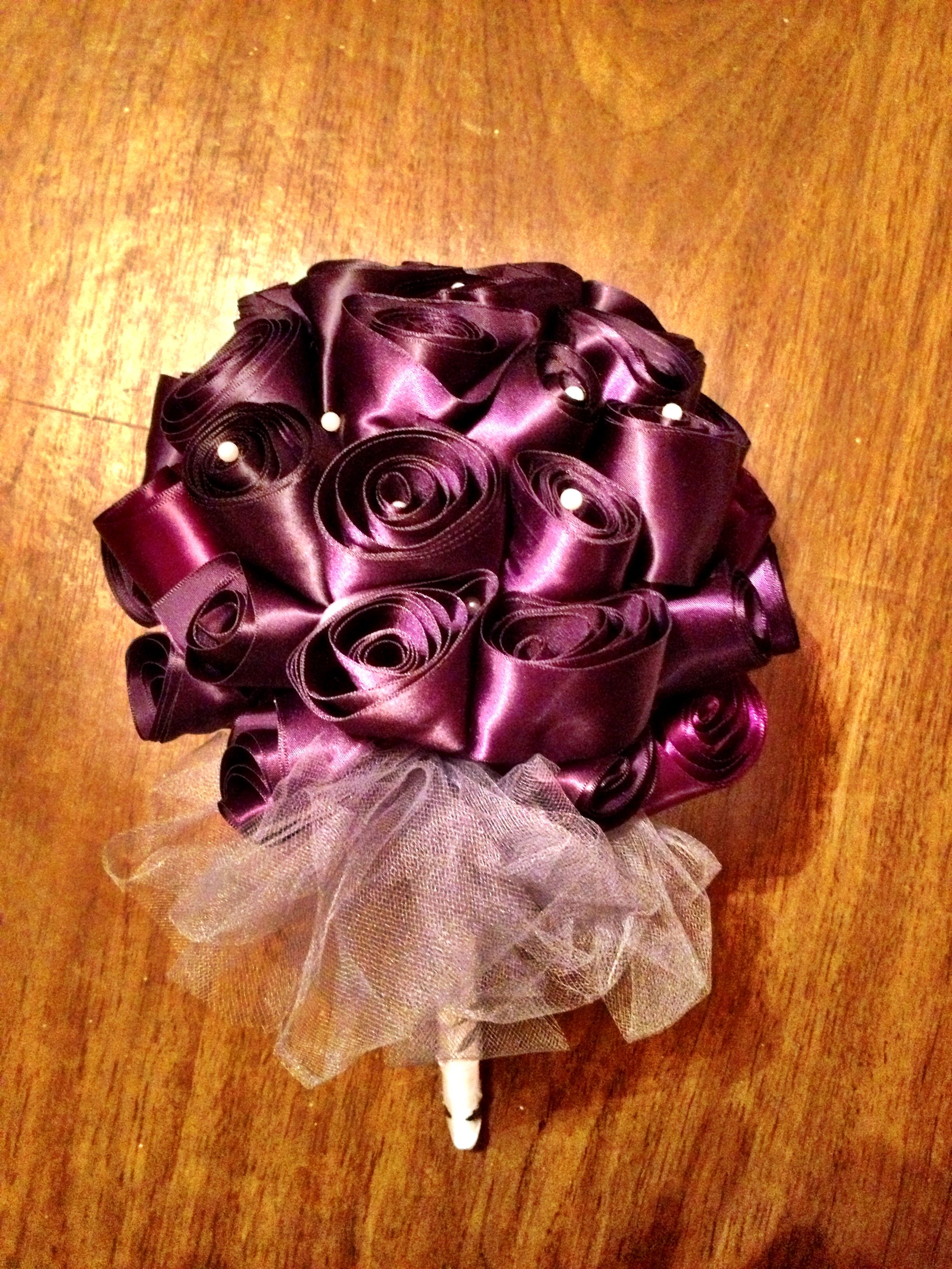 wedding rehearsal bouquet made from the couples wedding shower ribbons