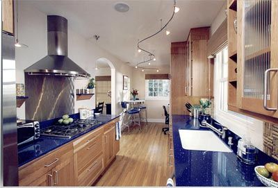 I 39 m not convinced the stained cabinets and blue counter for Blue countertops kitchen ideas