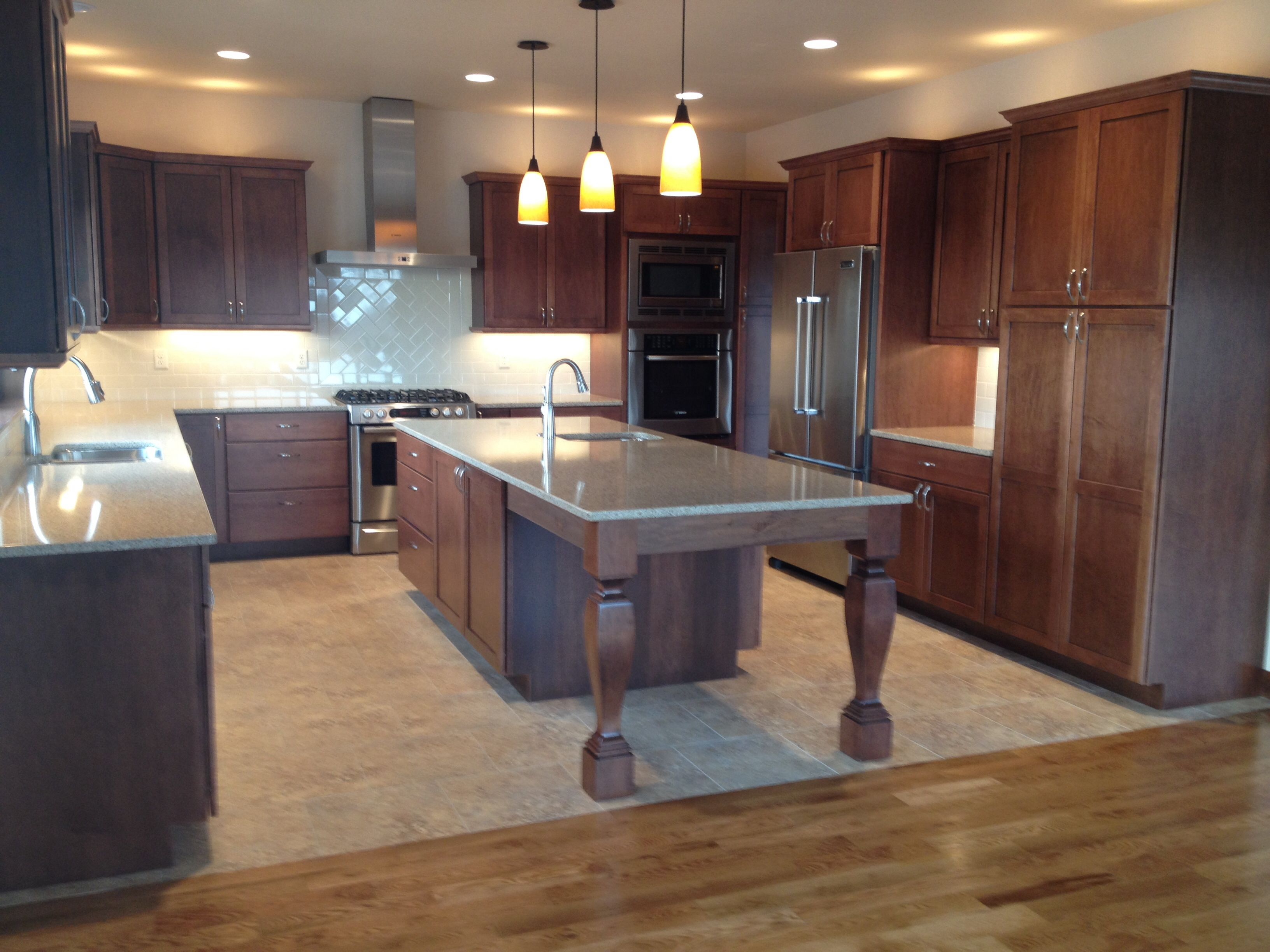 Grouted luxury vinyl tile flooring in kitchen meeting sand