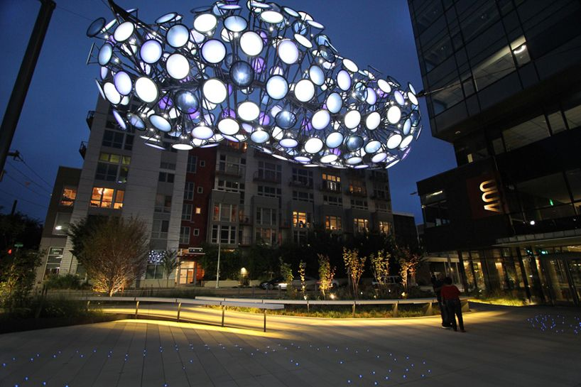 dan corson floats digital clouds above amazon plaza in seattle