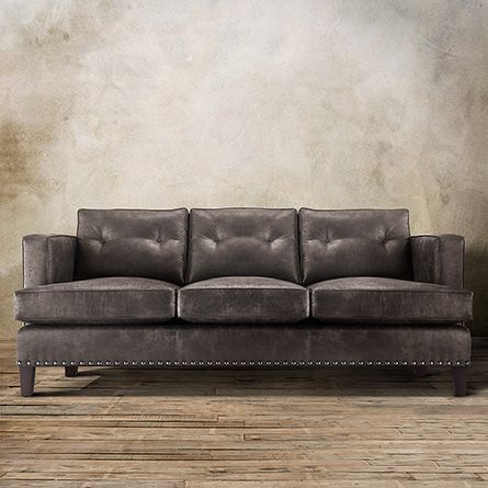 Embracing Mid Century Modern Style The Arhaus Flanders 84 Leather Sofa In Palance Steel Is Swathed A Durable Eco With Tufted Pillows