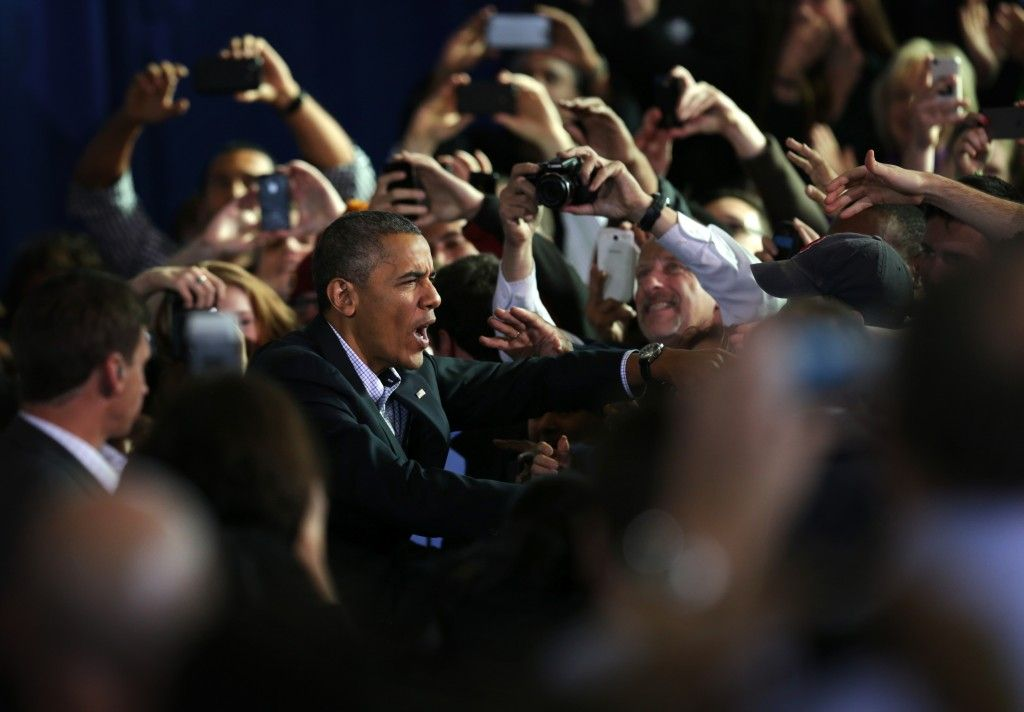 ARLINGTON, VA - U.S. President Barack Obama greets supporters as he arrives at a campaign rally of Democratic gubernatorial candidate for Vi...