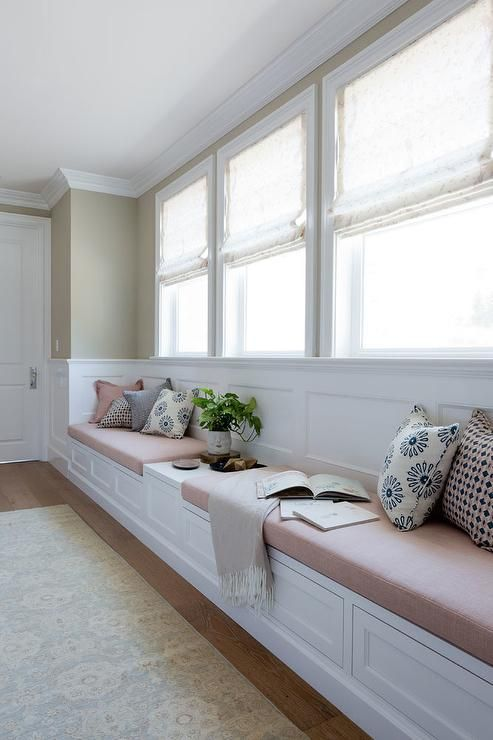 A Cream Colored Rug Sits In Front Of A Long Built In White Window Seat Fitted With Drawers And Blush Window Seat Kitchen Home Decor Bedroom Wainscoting Bedroom