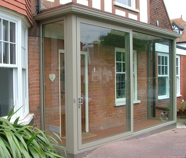 Aluminium porch love the design not so sure about colour for Enclosed front porch house extension