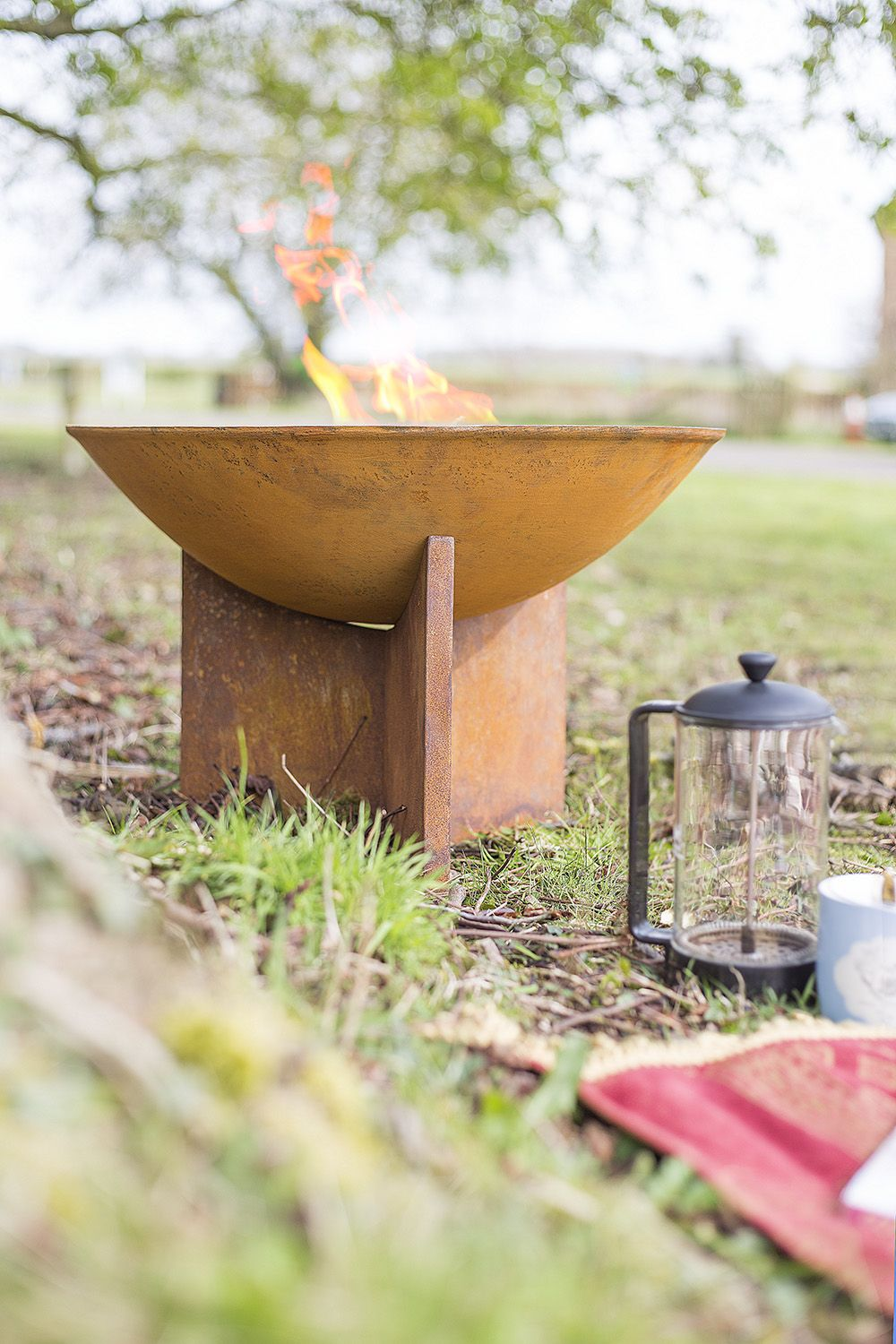 Kala Firepit with Rustic Oxidised Finish 58239 by La Hacienda. Fuss free and low maintenance, the perfect outdoor heater for an organic setting.