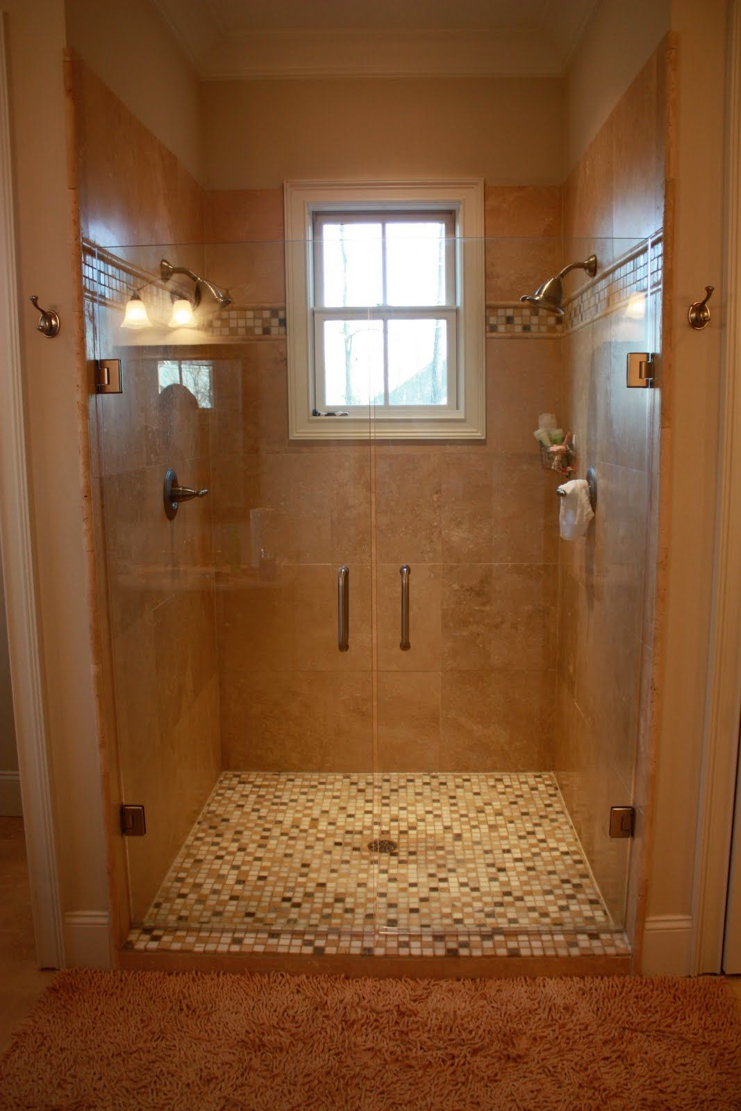 Dual shower heads in a smaller space. I don\'t like the tile combos ...