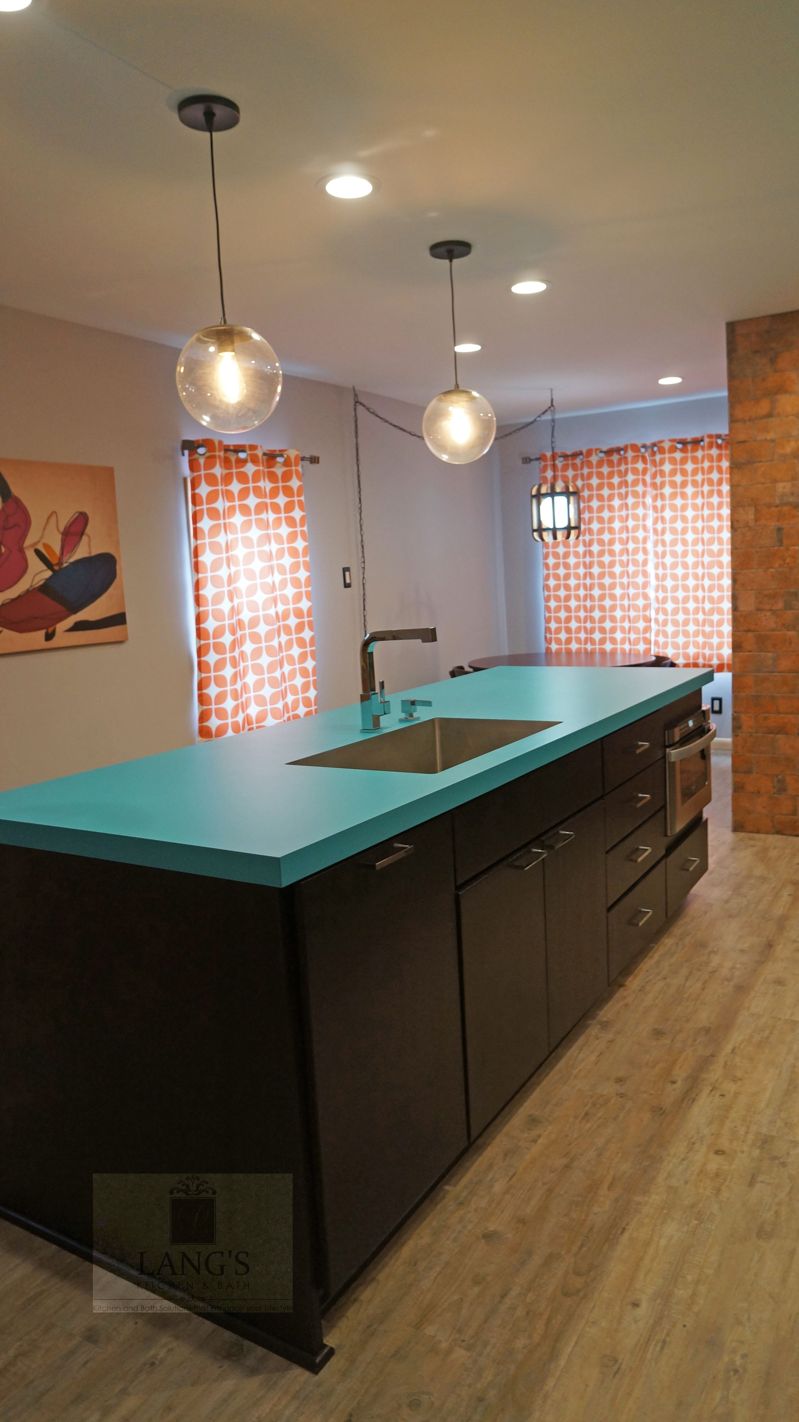 This dynamic kitchen design is oneofakind with a blue