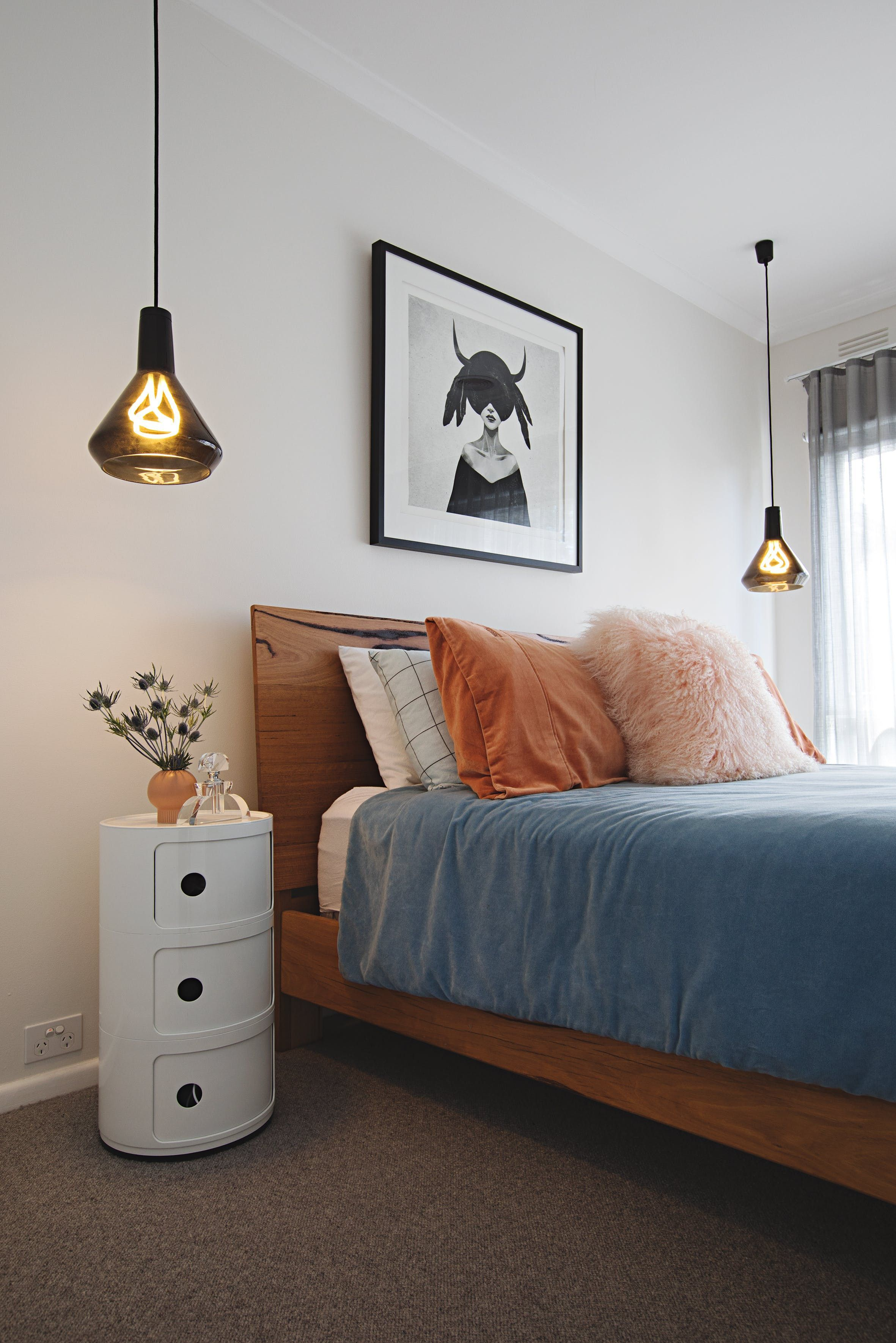 The Plumen Pendant Lights on either side of the bed are from
