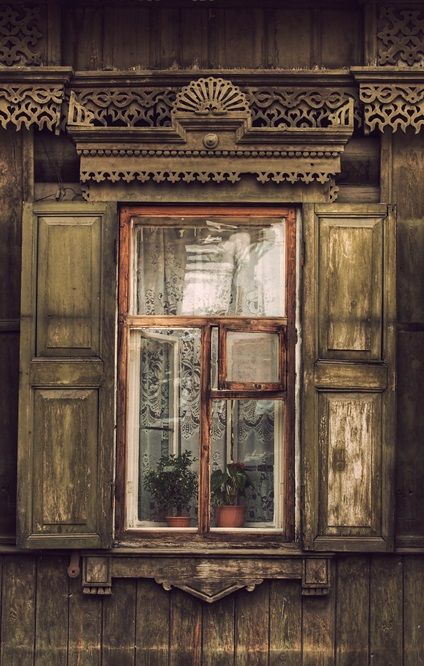 traditional decorative carved wood window frame, siberian region, russia   architectural details
