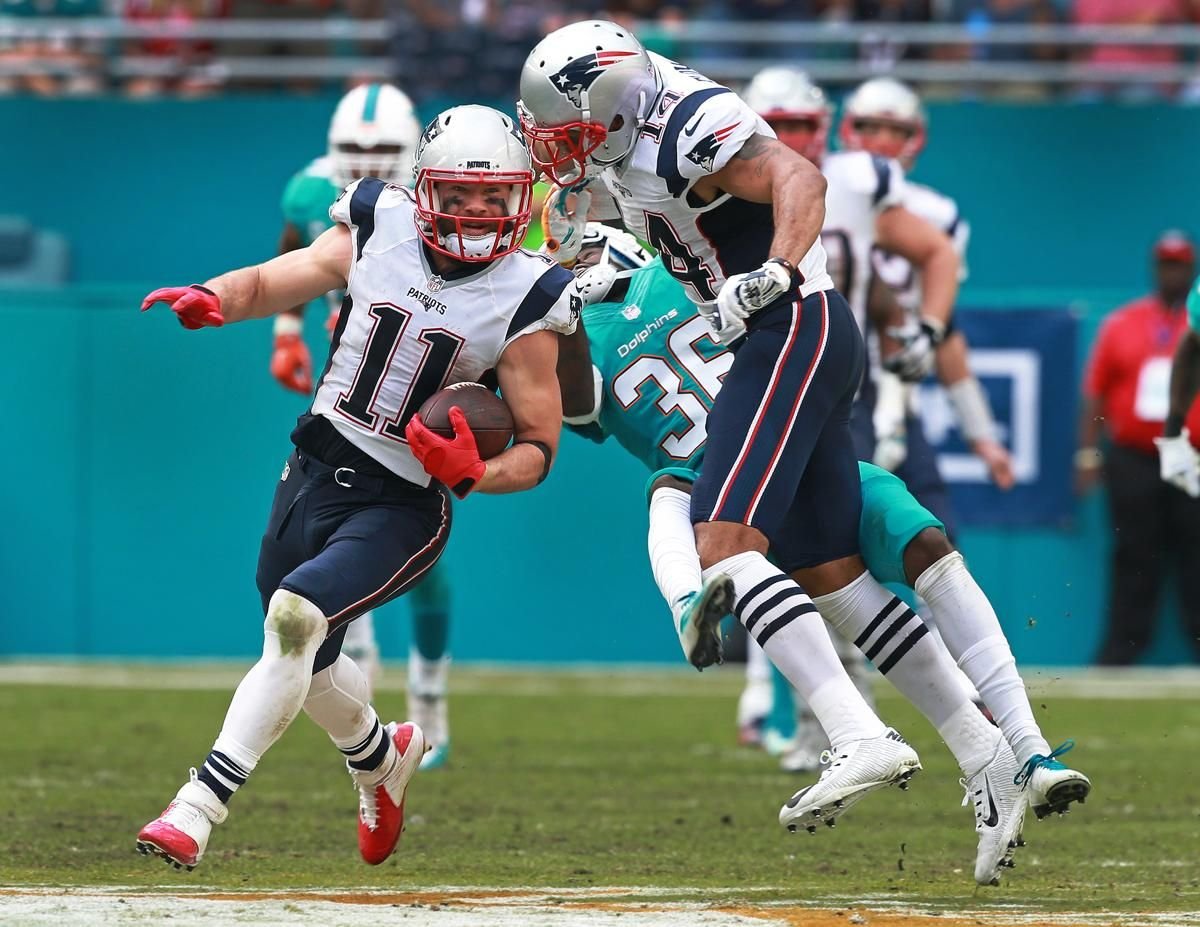 Patriots finish off Dolphins, secure No. 1 seed imagens)