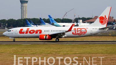 Thai Lion Air (TH) Boeing 737-8GP PK-LPJ aircraft, with the sticker ''150th Boeing Next Generation 737'', skating at Indonesia Jakarta Soekarno Hatta International Airport. 02/10/2015.