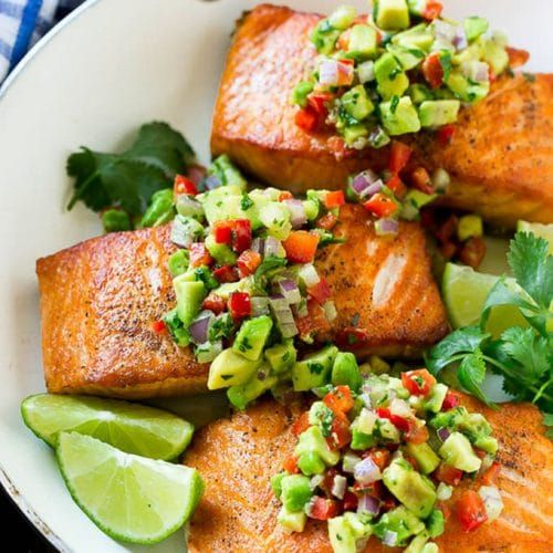 Skillet Roasted Salmon With Avocado Pomegranate And: Salmon With Avocado Salsa In A Frying Pan.