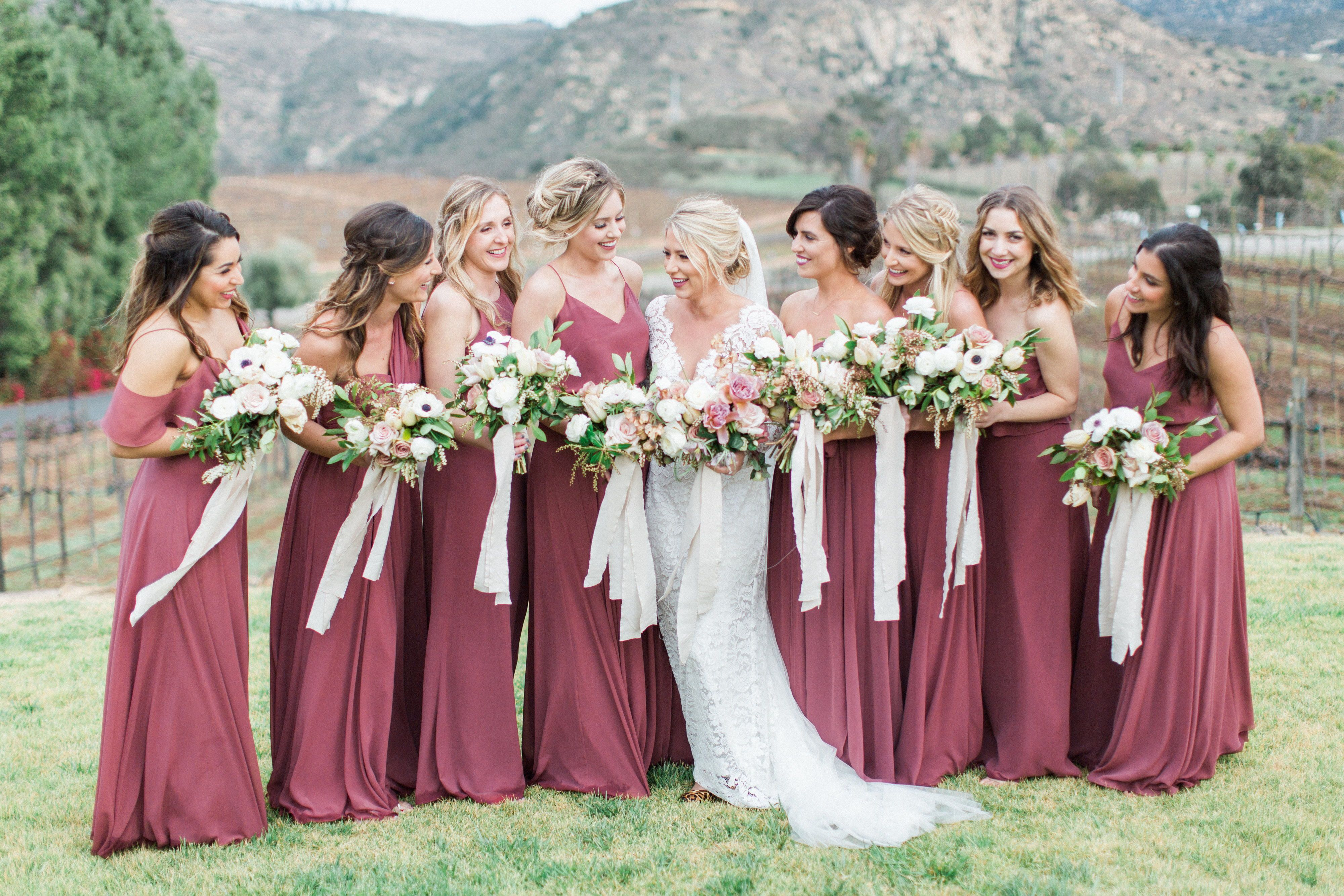 2bbe7b587b43a Jenny Yoo bridesmaids, various long luxe chiffon styles in a burgundy shade  called cinnamon rose. Shown is the Cahrlie, Inesse, Olivia, Mira and Mila.