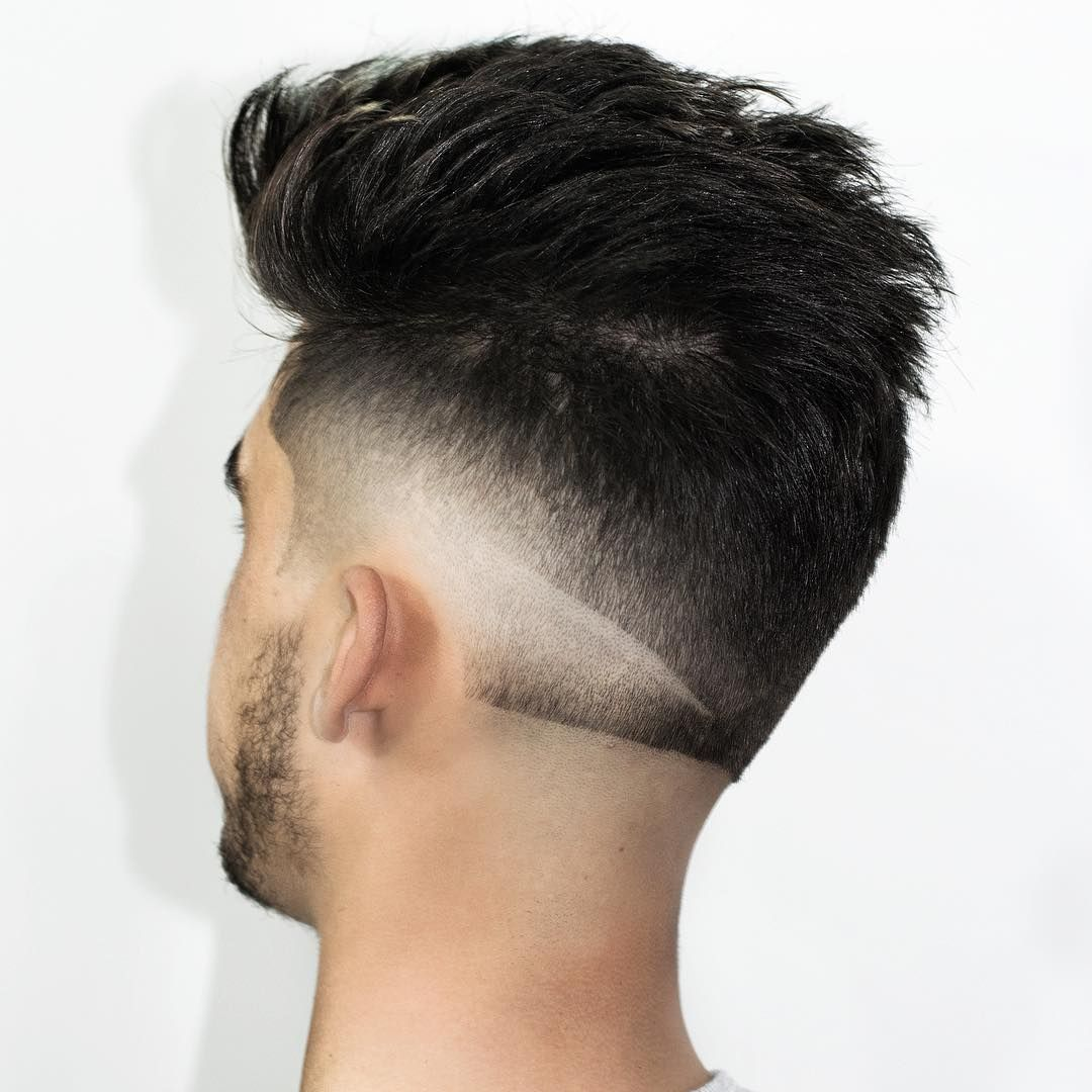 A straight across neckline with a burst fade and shaved line