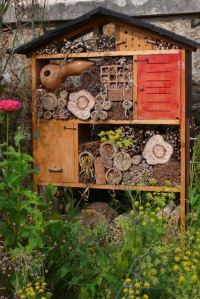 I want to make an insect hotel (perhaps with a hedgehog house and frog/toad house at the base of it) to go next to our little shed. #homesfornature.