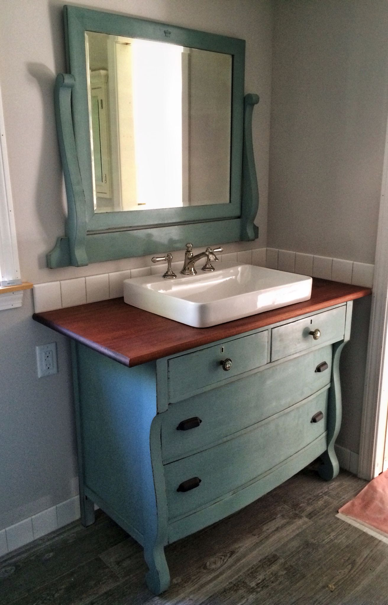 I just repurposed an old dresser to use as a vanity in our new bathroom i chalk painted it Used bathroom vanity with sink