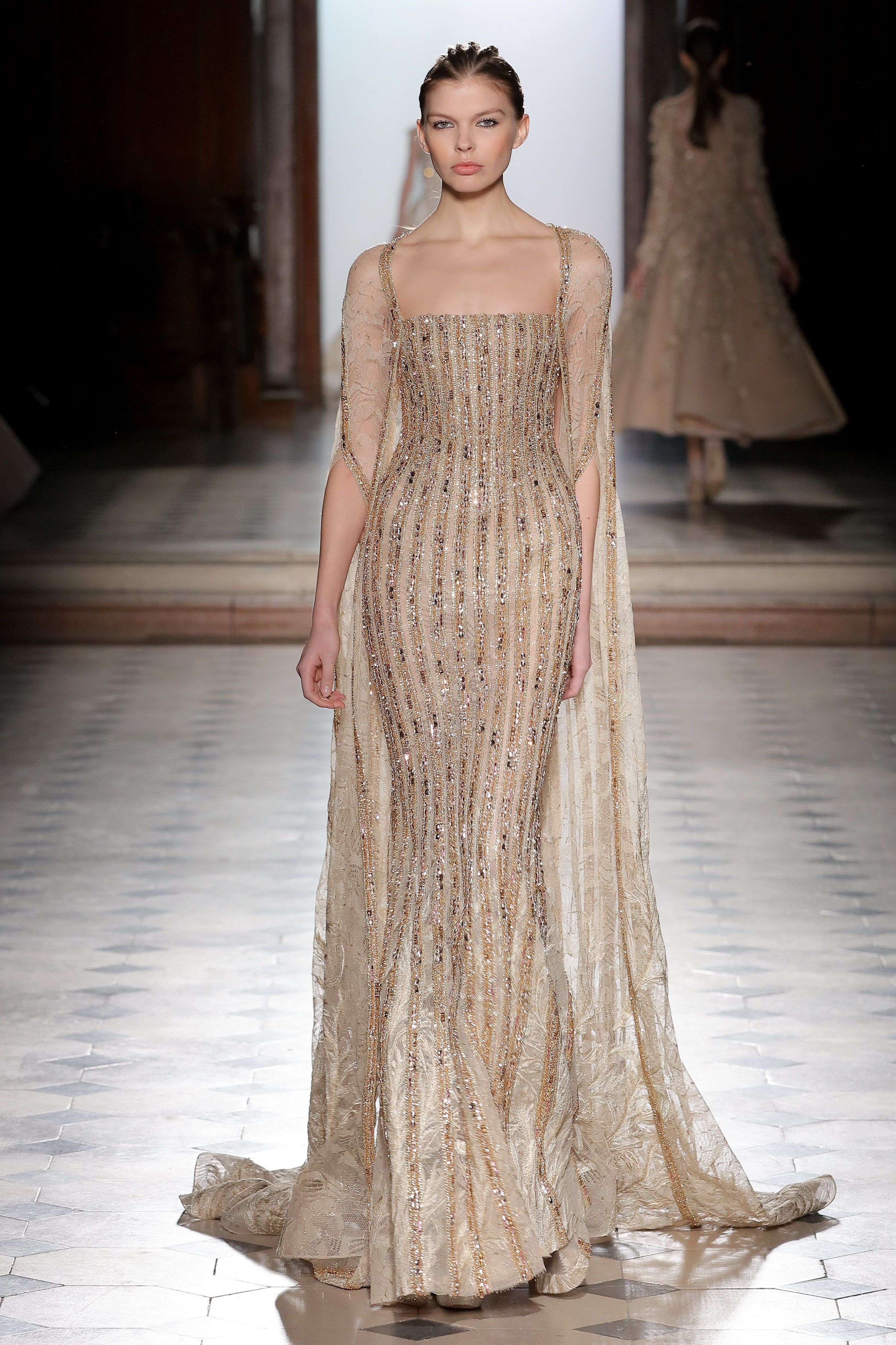5668344c092 Tony Ward Couture I Spring Summer 2018 I Nude lace mermaid dress with linear  gold embroideries and a cape.